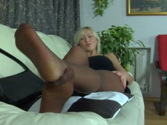 Heated blondie massaging her yummy feet right through her suntan pantyhosevideo